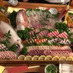 やますい - 刺身盛り九名分。残りのイカは天ぷらか焼きにしてくれます。