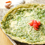 海鮮・かき・沖縄料理 わ - ヨモギでほろ苦、フーチーバーのヒラヤーチー。