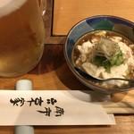 77448167 - 生ビール・お通し(おぼろ豆腐)
