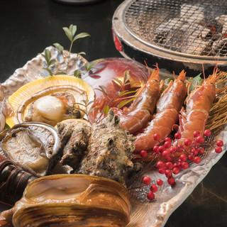 炭火で頂く海鮮と、お宝焼酎の組み合わせは絶品