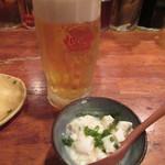 森の賢者 - オリオン生ビール(550円)とつき出しのゆし豆腐(200円)