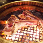 77709636 - 1712_FONZU PREMIUM GRILL & SHABU -北海道ビール園-_骨付きラム@65,000Rp×2 焼く際の脂が凄い!