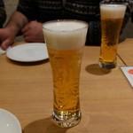 ハーレーパーク - 飲み放題。最初はビール。グラスもおしゃれ