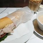 78236052 - ターキーのパニーノに、マッシュルームのスープ(ぬるめ)とアイスカフェオレ。合計1450円、ちと高い。