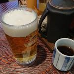 富金豚 - 生ビール。