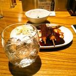 矢場とん - 2杯目は黒糖仕立ての奄美という30度の焼酎をロックで。600円(税別)