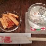ポコペンのペコポン - 『本日のサービス酎』鹿児島・喜界島の黒糖焼酎『朝日』です。小鉢も頂きました(お通し代350円)。