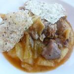 78994229 - ステファノシェフ厳選の豚肉とキャベツの白ワイン煮込み イタリア産ポレンタと共に