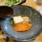 79575957 - 西京味噌を使った白ごま豆乳鍋 2色タレ(1,080円)