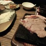 79577724 - 看板メニュー『長崎芳寿豚の溶岩焼き』