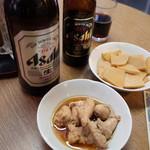 立飲み たきおか - 瓶ビールと黒ホッピー