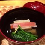 79780090 - お椀……胡麻豆腐                       温かいお出汁が美味しい、短冊に切った人参の赤のと大根の白が重ねてあり紅白ですね。