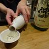 吉 - ドリンク写真:神亀の樽酒を燗で