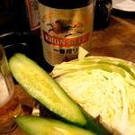 80336616 - お通しの野菜と瓶ビール。