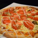 トラット - たっぷりトマトのダブルチーズピザ