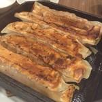 Benitoragyouzabou - 鉄鍋棒餃子