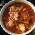 81138221 - 牛ホルモンつけ麺                       つけ汁(中辛)