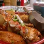 もつ焼き おとんば - おでん。蟹出汁唐辛子って珍しい。美味しくない理由が見当たらない。