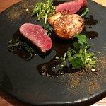 81331222 - 鴨胸肉のロースト。山椒マデラソース、春菊、豆腐、セリ、カブ。