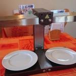 伊咲亭 - チーズ蕩けさせる機械