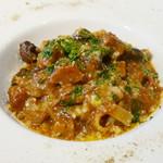 イル・ピノーロ - 赤鶏さつまのラグーとポルチーニ茸のタリアテッレ
