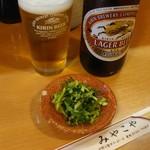 81487791 - 中瓶ビールと定食の漬物