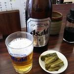 高橋 - 瓶ビール(中) 550円とお通し