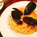 82256232 - ムール貝と蟹とアメリケーヌを使ったチーズリゾット 1,200円