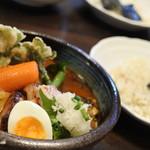 82459229 - 厚切り豚ロースの西京焼きと春野菜のスープカレー  1600円