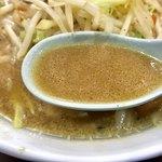 82468928 - 味噌ラーメンのスープ                       味濃い目の昔ながらの味噌味