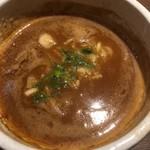 82786111 - 特製伊勢海老つけ麺のつけ汁、汁の中にメンマが