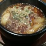 82826605 - ぐつぐつ沸き立っているカルビつけ麺のスープ。