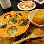 酒亭 道や - 栄螺のエスカルゴバター焼き