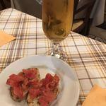83025977 - ハートランドの生ビールと、ブルスケッタ(お通し)