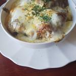 マドラス - 焼きチーズカレー (唐揚げトッピング) 大きめの唐揚げが4個でした。