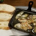 立喰酒場 金獅子 - 牡蠣のアヒージョ