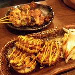 炭火焼 割鮮 煉 - 蓮根の肉詰め焼き(350円) 蓮根の食感とお肉の風味、からしがアクセントになってこれ好きだな~。