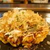 鉄板焼 よろづや - 料理写真:③関西豚玉の焼き上がり、分厚く焼き上げる800円