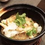 83962207 - たらば蟹入り海鮮、春雨、薄ピリ辛土鍋煮 2400円