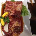 炭火焼肉 寿月 - ジャンボ骨付きカルビ(小)