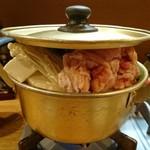 84177626 - 豚もつ鍋  基本の醤油味