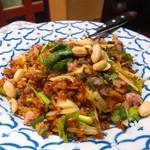 居酒屋 タイ - ネームックっ。辛いけどコクもあって激ウマ。ソーセージとお米とスパイス。辛さは調節してくれますよ。