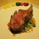 84393557 - オーストラリア産仔羊の骨付きロースト 5種の彩りソースで(パプリカ 根セロリ りんご ほうれん草 赤玉ねぎ ビーツ)葱と菜の花のリゾットを敷いて2