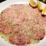 漢江 - ネギ塩焼肉上タン塩 ¥2,200  2人前 普段は厚切りタン派ですが、片焼きのネギ塩焼肉はこの薄さがベストでした。サシが均等に細かく入っていて、とても上質です。