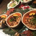 地鶏と完全個室 伊蔵 - 付き出しの鶏皮ポン酢