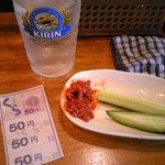 立呑み処 くら - レモンサワーとモロキュー¥150 食べかけですが