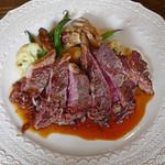 イヴォワール - 十勝産羊もも肉ステーキ エシャロットソース