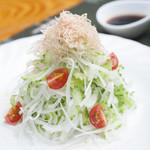 沖縄料理の店 くすくす - しゃきしゃきゴーヤーサラダ