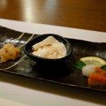 85697491 - お通し:岩魚の塩辛・おぼろ豆腐の熟成醤油がけ・ホヤの酒盗 