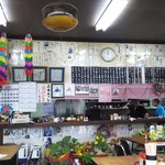 85938053 - 店内は色紙・写真・千羽鶴に飾られた昭和食堂